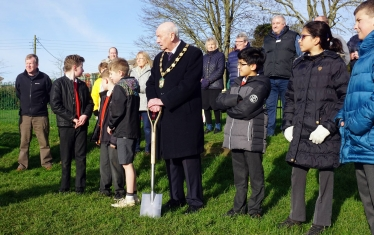 District Council Chairman Steve England leads the turf cutting ceremony.